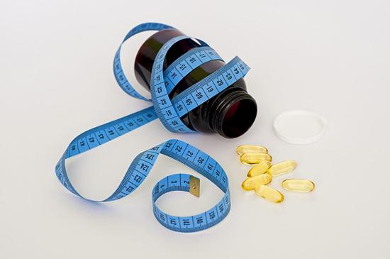 Prášky pro redukci tělesných tuků a podporu hubnutí